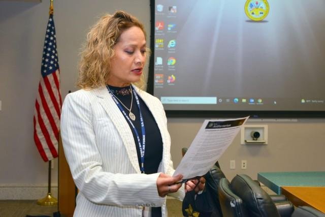 Janice Quenga, U.S. Army Garrison Presidio of Monterey antiterrorism officer, reads the Antiterrorism Awareness Month Proclamation at garrison headquarters, Presidio of Monterey, Calif., Aug. 24.