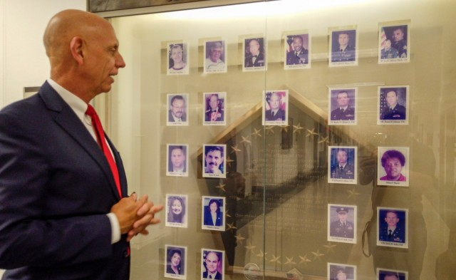 Franklin Childress, director of Army Reserve communications,  stands by a memorial he designed in the Pentagon, honoring the 29 people killed on 9/11 from the offices of the Assistant Secretary of the Army for Manpower and Reserve Affairs and the Deputy Chief of Staff for Personnel.