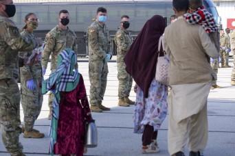 Afghan evacuees arrive in Indiana, head to Camp Atterbury