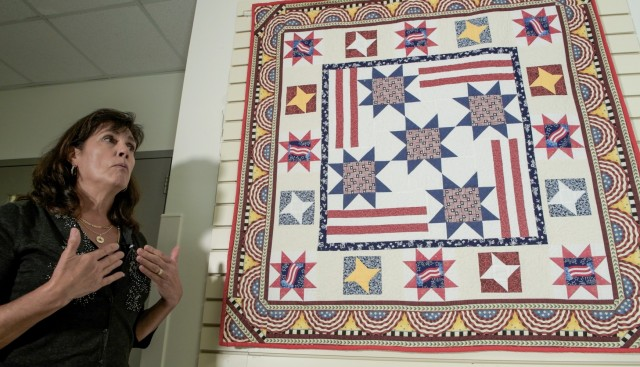 Diane Murtha explains the Stars of Liberty Quilt currently on display at the Pentagon Quilts memorial in Washington, D.C., Aug. 20, 2021. The quilt is a collective project by the Black Forest Quilt Guild, a group Murtha and more than 70 German and Americans participated in while stationed in Stuttgart, Germany.