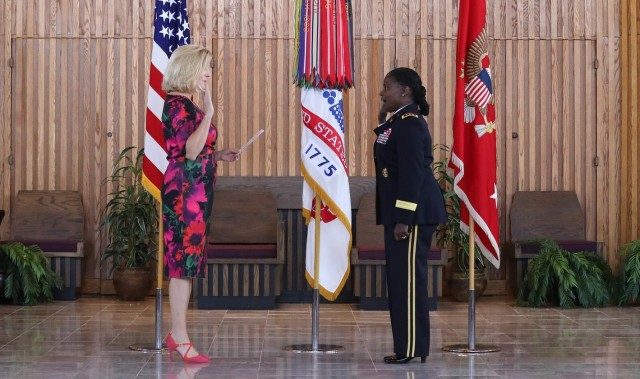 Secretary of the Army Christine E. Wormuth, left, swears in Lt. Gen. Donna Martin as the Army's inspector general during a ceremony Sept. 2, 2021. Martin previously spent a year as the Army's provost marshal general.