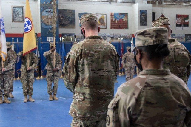 Brig. Gen. Lance G. Curtis and Command Sgt. Maj. Phelicea M. Redd, the command team for 3rd Expeditionary Sustainment Command, bow their heads during the invocation given at a transfer of authority ceremony at Camp Arifjan, Kuwait, on Aug. 28, 2021. The ceremony was symbolic of 3rd ESC, deployed out of Fort Bragg, North Carolina, assuming the operational command post mission for the 1st Theater Sustainment Command from the 310th Expeditionary Sustainment Command. (U.S. Army photo by Sgt. 1st Class Mary S. Katzenberger)