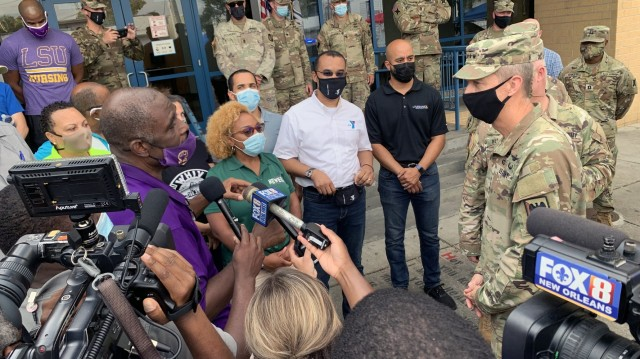 Army Gen. Daniel Hokanson, chief, National Guard Bureau, talks with community leaders during a visit to assess the Hurricane Ida response and thank troops in New Orleans, Louisiana, Sept. 7, 2021. This image was acquired using a cellular device. (U.S. Army National Guard photo by Master Sgt. Jim Greenhill)