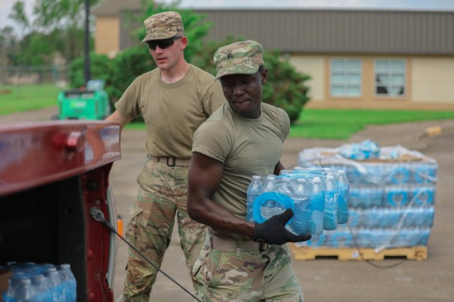 Oklahoma National Guard Sgt. Stephen Bruke hands out water at a point of distribution site in Gramercy, Louisiana, Sept. 4, 2021. The Oklahoma National Guard operates 13 PODs across seven parishes that supply families with tarps, meals ready to eat, ice and water. (Oklahoma National Guard photo by Cpl. Reece Heck)