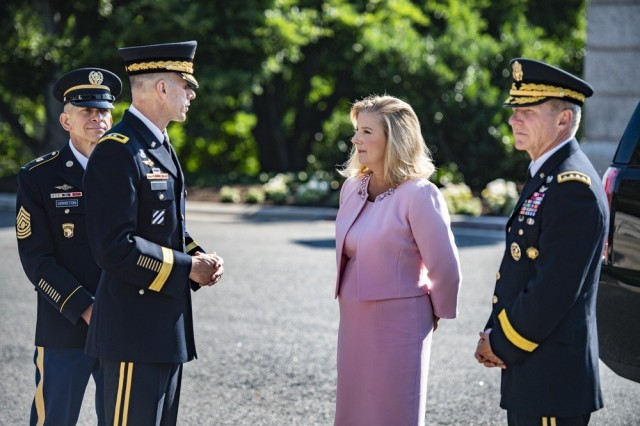 Secretary of the Army Christine E. Wormuth, second from right, Chief of Staff of the Army Gen. James C. McConville, right, and Sgt. Maj. of the Army Michael A. Grinston, left, speak with Maj. Gen. Allan Pepin, commander of the Joint Force Headquarters-National Capital Region and Army Military District of Washington in Arlington, Va., June 14, 2021.