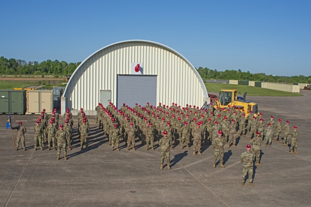 Members of the 201st Rapid Engineer Deployable Heavy Operational Repair Squadron Engineers, or REDHORSE, Detachment 1 pose for a picture at Biddle Air National Guard Base in Horsham, Pennsylvania, May 15, 2021. This is the first official group photo of the 201st REDHORSE Det. 1 in the Operational Camouflage Pattern, or OCP, utility uniform on base since they returned from their recent deployment overseas. (U.S. Air National Guard Photo by Senior Airman Wilfredo Acosta)