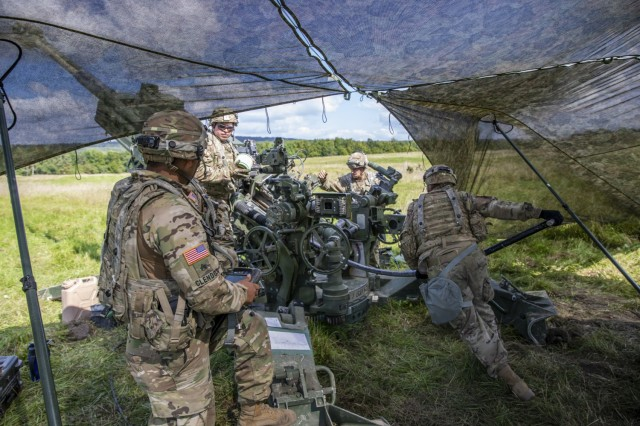 Soldiers with Archer Battery, Field Artillery Squadron, 2nd Calvary Regiment, load their assigned M777A2 Howitzer before firing during the live-fire exercise Saber Junction 21 Sept. 1, 2021, in Grafenwoehr Training Area, Germany. The U.S. Army Europe and Africa directed exercise is designed to assess the readiness of units under 7th Army Training Command to conduct unified land operations in a joint, combined environment and to promote interoperability with participating Allies and partner nations.