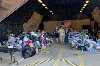 Spouses Club answers call, leads Afghan donation drive