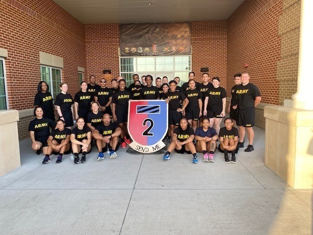 Soldiers assigned to 2nd Armored Brigade Combat Team, 3rd Infantry Division, pose for a group photo after a unit physical training session in honor of the staff changeover of the officer in charge of the brigade human resource office at Fort Stewart, Georgia, July 15, 2021. As opposed to the pomp and circumstance that surrounds a change of command, a staff changeover often goes unnoticed to individuals not directly affected by the office on a day-to-day basis and those outside the unit. (Courtesy photo)