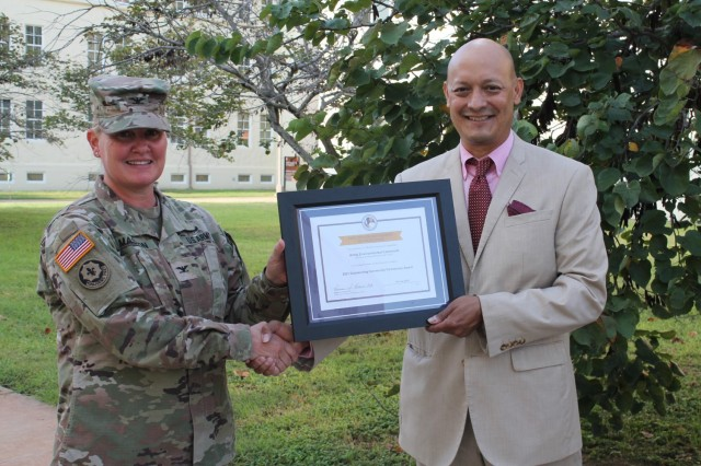 Dr. Joseph Cerna, principal of Fort Sam Houston Elementary School, presents the Pete Taylor Partnership of Excellence award for Outstanding Community Partnership K12 to Col. Alicia M. Masson, commander of U.S. Army Environmental Command, during a ceremony held at Fort Sam Houston on Sept. 8.