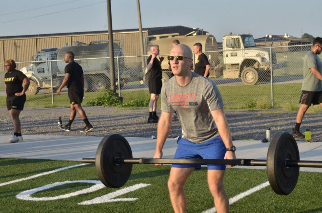 Second Lieutenant Chris Edwards, an unassigned Army Chaplain candidate from U.S. Army Chaplain Recruiting Team-North Central Illinois, completes a deadlift exercise during physical training Sept. 2 at the Bastogne physical training field. Edwards was among dozens of candidates attending the inaugural Army Chaplain Experience Day, which simulated a day in the life of a Soldier and provided valuable information about the chaplaincy.