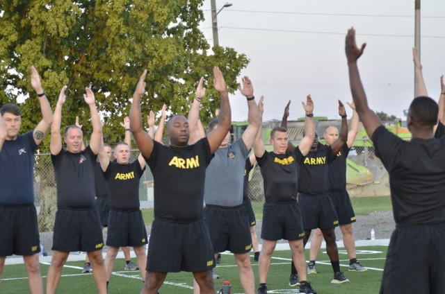 Army Chaplain candidates from across the U.S come together for a physical training session Sept. 2 at the Bastogne PT field, part of the inaugural Army Chaplain Experience Day.