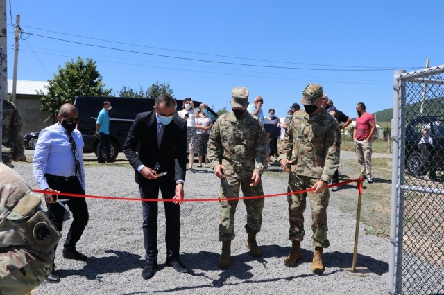 U.S. Army Corps of Engineers Caucasus Project Office Chief Jorge Pachas, Mtskheta Mtianeti Georgain State Representative David Nozadze, Adjutant General of the Georgia National Guard Maj. Gen. Thomas Carden and Maj. Dan Sekula of the Office of Defense Coordination in the U.S. Embassy in Tbilisi, Georgia cut the ceremonial ribbon during a ceremony recognizing the completion of a newly constructed water storage tank and electric-powered pump station serving the Prezeti Internally Displaced Persons settlement in the Mtskheta region of the Republic of Georgia. The U.S. Army Corps of Engineers, Europe District recently completed the water supply project through the U.S. European Command's Humanitarian Assistance program, in close coordination with the U.S. Embassy in Tbilisi. (Photo courtesy of the U.S. Embassy in Tbilisi)