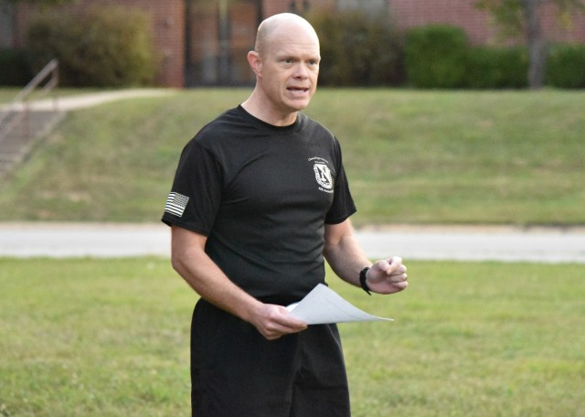 U.S. Army Chemical, Biological, Radiological, and Nuclear School Ethics Instructor and Regimental Chaplain (Maj.) Jason Southard addresses a group of nearly 50 CBRN Soldiers, who volunteered to participate in a sunrise 5k run Sept. 10. The run ― which started and finished in front of the Digital Training Facility ― gave the group the chance to come together to reflect on 9/11 and the ensuing Global War on Terror, and their roles as service members.