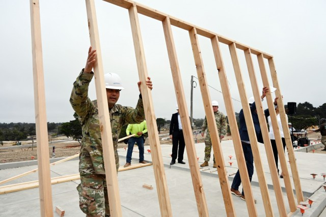 Col. Varman Chhoeung, left, commander of U.S. Army Garrison Presidio of Monterey, raises the first vertical wall of the Lower Stilwell housing development with Ted Lim of The Michaels Organization LLC, the Army's commercial partners in developing and overseeing military housing on the Monterey Peninsula, at the Ord Military Community, Calif., Sept. 8.