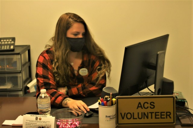 Latishia Hampton, military spouse and Fort Campbell Army Community Service volunteer coordinator, reviews an email Sept. 7 at ACS. Volunteering can provide work experience that is a great addition to a resume.