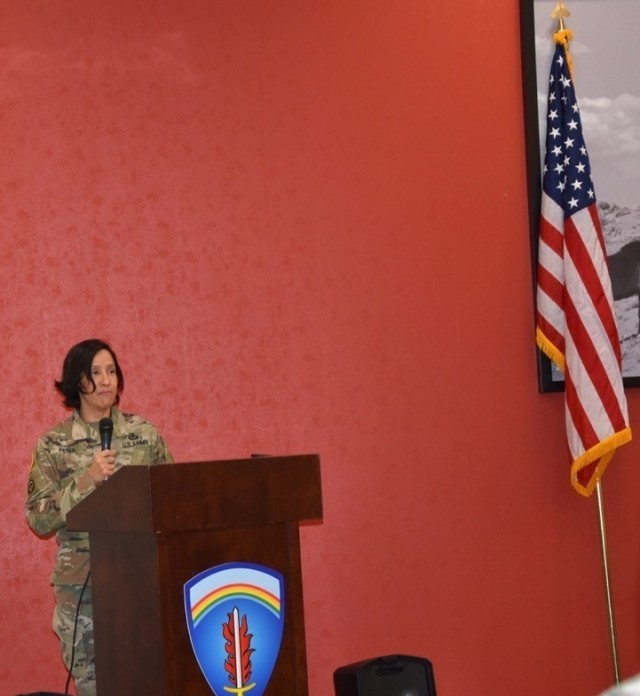Lt. Col. Claudia Pena with G5, U.S. Army Europe-Africa, speaks at the Women's Equality Day ceremony at the dining facility Aug. 26 at Clay Kaserne.