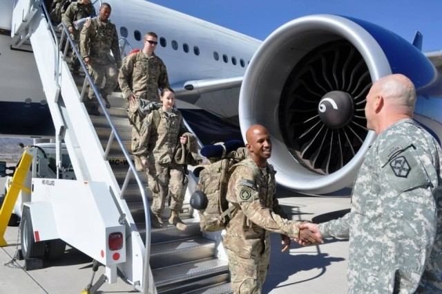 U.S. Army Command Sgt. Maj. Aarion Franklin, Maryland National Guard, is greeted after returning from deployment to Afghanistan Jan. 28, 2014, at Fort Bliss, El Paso, Texas. Franklin was among the many MDNG members who responded to the attacks on Sep. 11, 2001. (courtesy photo)