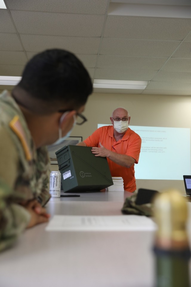 Kenneth Harwell, a quality assurance ammunition specialist, explains the process for lot numbers on ammunition containers to Soldiers from the 24th Ordnance Company, 87th Division Sustainment Support Battalion, 3rd Division Sustainment Brigade during a demilitarization class at Fort Stewart Georgia September 9. The class was taught to enhance the knowledge of ammunition specialists assigned to the 24th who are responsible for the receiving, storing and issuing of ordnance. (U.S. Army photo by Staff Sgt. Joel Salgado, 3rd Division Sustainment Brigade Public Affairs)