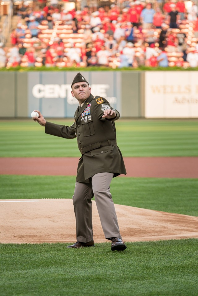Maneuver Support Center of Excellence and Fort Leonard Wood Command Sgt. Maj. Randolph Delapena throws a ceremonial pitch Saturday during the pre-game ceremonies for the annual St. Louis Cardinals and AUSA Military Appreciation Game at Busch Stadium.
