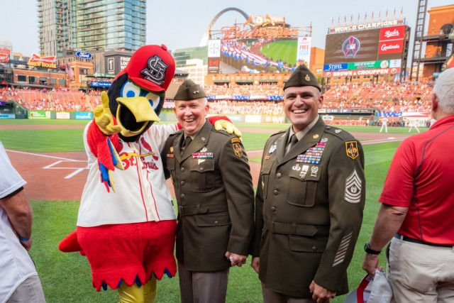 Maj. Gen. James Bonner, Maneuver Support Center of Excellence and Fort Leonard Wood commanding general (center), and MSCoE and Fort Leonard Wood Command Sgt. Maj. Randolph Delapena met Fredbird, the St. Louis Cardinals' mascot, Saturday during the pre-game ceremonies for the annual AUSA Military Appreciation Game at Busch Stadium.