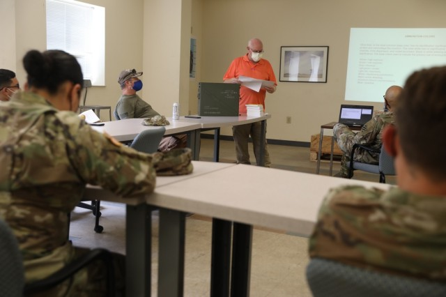 Kenneth Harwell, a quality assurance ammunition specialist, instructs Soldiers from the 24th Ordnance Company, 87th Division Sustainment Support Battalion, 3rd Division Sustainment Brigade on identifying ammunition markings during a demilitarization class at Fort Stewart Georgia September 9. The class was taught to enhance the knowledge of ammunition specialists assigned to the 24th who are responsible for the receiving, storing and issuing of ordnance. (U.S. Army photo by Staff Sgt. Joel Salgado, 3rd Division Sustainment Brigade Public Affairs)