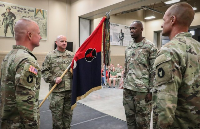Command Sgt. Maj. Jeremy Strasser, the incoming senior enlisted leader of the 2nd Infantry Brigade Combat Team, 34th Infantry Division, Iowa Army National Guard, holds the unit colors during the change of responsibility ceremony for the 2nd Infantry Brigade Combat Team, 34th Infantry Division, at the Camp Dodge Joint Maneuver Training Center on Sept. 10, 2021. The ceremony was a unique event, as Jeremy assumed responsibility from his older brother, Command Sgt. Maj. Matthew Strasser. The two brothers have dedicated a combined 47 years of service to the Red Bull brigade. (U.S. Army National Guard photo by Staff Sgt. Tawny Schmit)