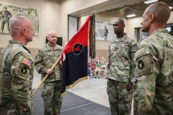 A 'family business': top enlisted leader of Iowa brigade passes unit colors to brother