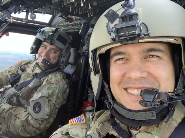 U.S. Army Chief Warrant Officer 3 Mauricio Garcia, right, pilots a 12th Aviation Battalion UH-60M Black Hawk, with his co-pilot, Chief Warrant Officer 3 Kevin Wikstrom.