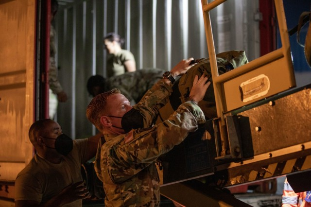 GRAFENWOEHR, Germany - V Corps Soldiers unload their luggage after arriving at Grafenwoehr, Germany, early September, in preparation for V Corps' upcoming certifying training event, Warfighter 22-1. The exercise, which will take place Sept. 27 to Oct. 6, will be V Corps' final step in becoming the U.S. Army's fourth corps and America's forward deployed corps in Europe. (U.S. Army photo by Daniela Vestal/Released)