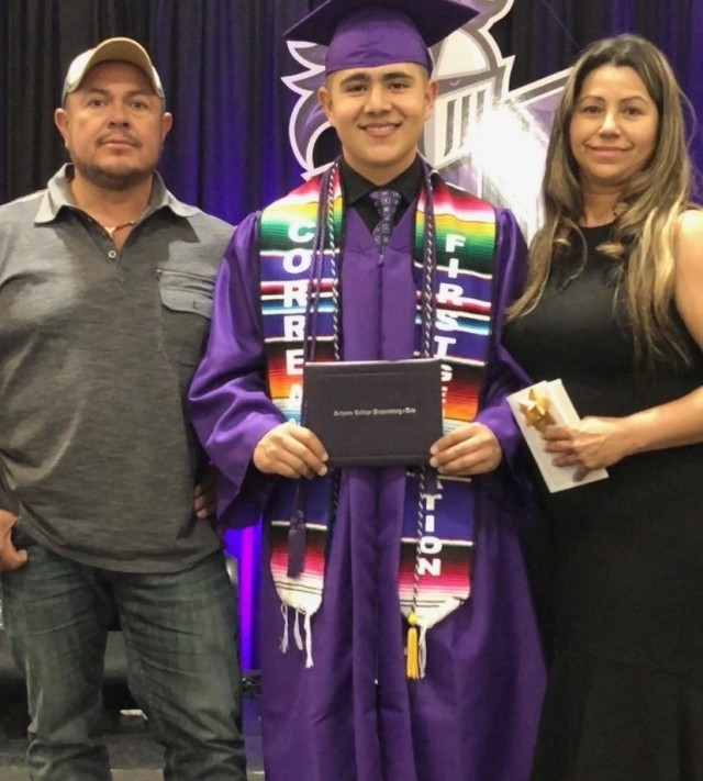 Cadet Ricardo Correa pictured with his parents, Jose and Eugenia, at his graduation from Arizona College Prep High School in 2018.   Photo provided by Ricardo Correa.