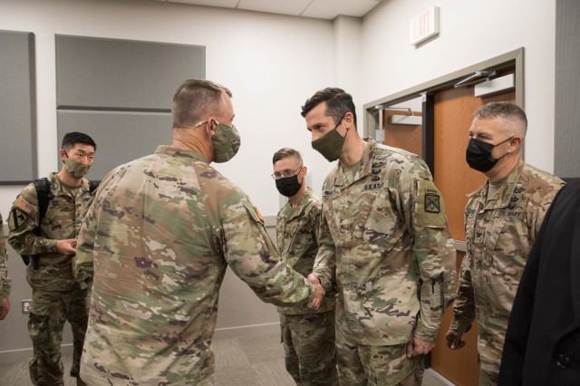 U.S. Army Gen. Paul Funk II, commanding general, Training and Doctrine Command, awards a coin of excellence to Maj. Jeremy Medaris for exemplary support during Operation Allies Refuge Aug. 5, 2021 at Ft. Lee, Virginia. The Department of Defense, in support of the Department of State, is providing transportation and temporary housing for Afghan special immigrant applicants recently relocated to the United States to complete the final steps of the immigration process. This initiative follows through on America's commitment to Afghan citizens who have helped the United States, and provides them essential support at secure locations outside Afghanistan, where they and their families can complete the Special Immigrant Visa process safely. (U.S. Army photo by Spc. Cody Nelson)
