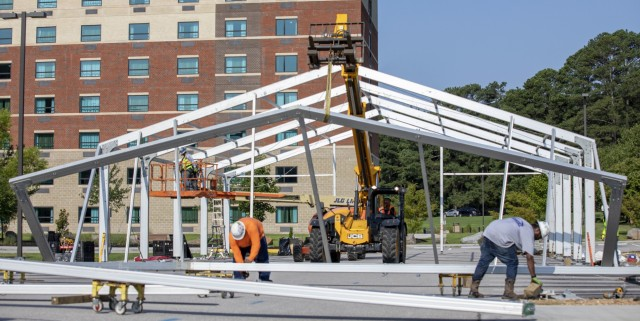 Civilian contractors construct support structures for Operation Allies Refuge, July 26, 2021 in preparation for the arrival of Afghan special immigrant applicants at Fort Lee, Virginia. The Department of Defense, in support of the Department of State, is providing transportation and temporary housing for Afghan special immigrant applicants recently relocated to the United States to complete the final steps of the immigration process. This initiative follows through on America's commitment to Afghan citizens who have helped the United States, and provides them essential support at secure locations, where they and their families can complete the Special Immigrant Visa process safely. (U.S. Army photo by Spc. Christopher Rodrigo)