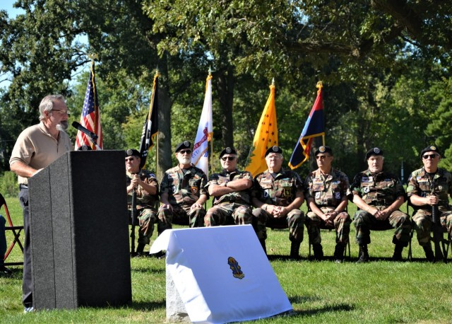 Roger Gilmore of the Americal Legacy Foundation speaks to event attendees about the importance of preserving the legacy of the division at the Americal Division Memorial Dedication at Rock Island National Cemetery in Illinois. Photo by: Staci-Jill Burnley, ASC Public Affairs