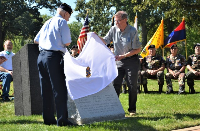 World War II Americal veteran, Walter Lehman, and Americal Legacy Foundation's Roger Gilmore participate in the official unveiling of the Americal Division Memorial at Rock Island National Cemetery in Illinois. Photo by: Staci-Jill Burnley, ASC Public Affairs