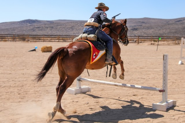 Specialist Bryan Mosqueda, Horse Detachment, Regimental Headquarters and Headquarters Troop, 11th Armored Cavalry Regiment, execute's a show jump while participating in the Horse Detachment's Internal Competition. This competition prepares Troopers for the upcoming National Cavalry Competition.