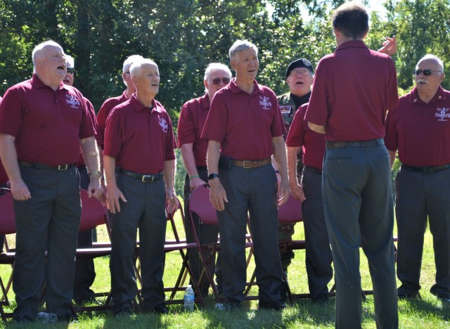 Attendees at the Americal Division Memorial Dedication at Rock Island National Cemetery in Illinois were treated to a patriotic musical presentation by the Chord Busters choral group from Davenport, Iowa. Photo by: Staci-Jill Burnley, ASC Public Affairs
