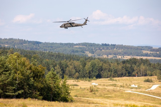 A UH-60M Black Hawk helicopter, operated by Soldiers assigned to the 12th Combat Aviation Brigade, conducts an aerial firing exercise on Grafenwoehr Training Area, Germany, Sep. 14, 2021. Soldiers assigned to 12th CAB are currently training for an event called Royal Black Hawk where they will train alongside the French military in October.