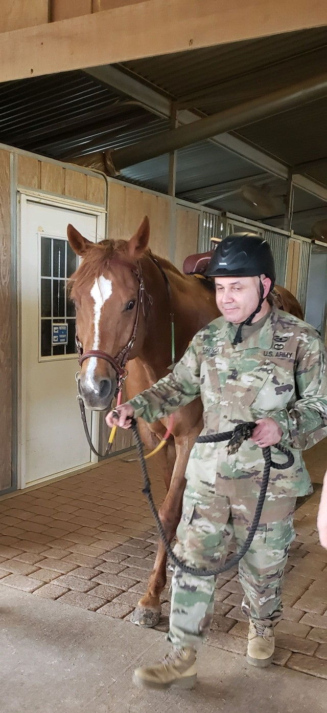 Sgt. Maj. George Olivencia, a Soldier assigned to the Fort Hood Soldier Recovery Unit, Texas, participated in a therapeutic horseback riding program on May 24 at a facility located in McGregor, Texas. (Photo courtesy of Amy Summers)