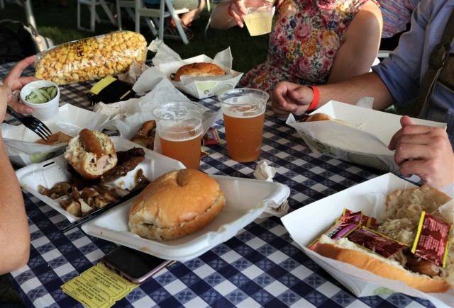 Attendees enjoy a variety of German-inspired fare at the annual Fort Knox Oktoberfest celebration Sept. 17, 2021, to include pretzels, bratwurst and schnitzel. German beer and wine were also available.