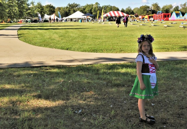 A girl dressed in traditional German attire stands overlooking Brooks Field where the annual Fort Knox Oktoberfest celebration took place Sept. 17, 2021.