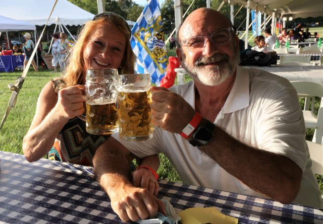 A couple toasts their steins of German beer at the annual Fort Knox Oktoberfest celebration Sept. 17, 2021, on Brooks Field.
