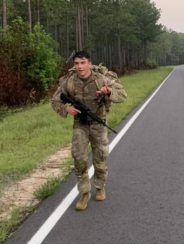 Staff Sgt. Charles Laabs of the 915th Cyberspace Warfare Battalion completes a 12-mile road march at Fort Gordon, Ga., as part of U.S. Army Cyber Command's 2021 Best Warrior Competition. Laabs went on to earn the title of ARCYBER Best Warrior NCO of the Year. (Photo by Command Sgt. Maj. Marlene Harshman)