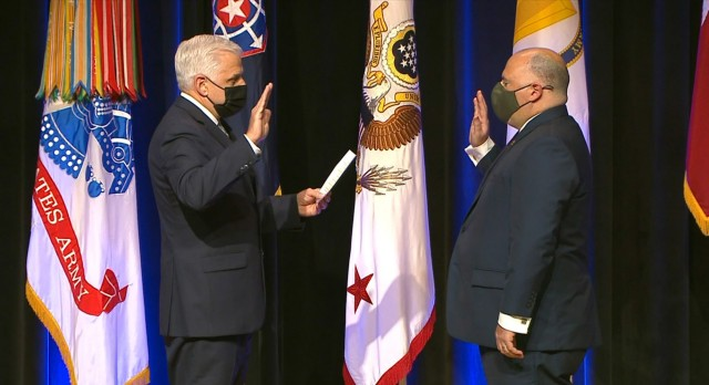 Christopher Lowman, left, administers the Oath of Office to SA Gregory Ford, swearing him in as the first director of the U.S. Army Criminal Investigation Division.