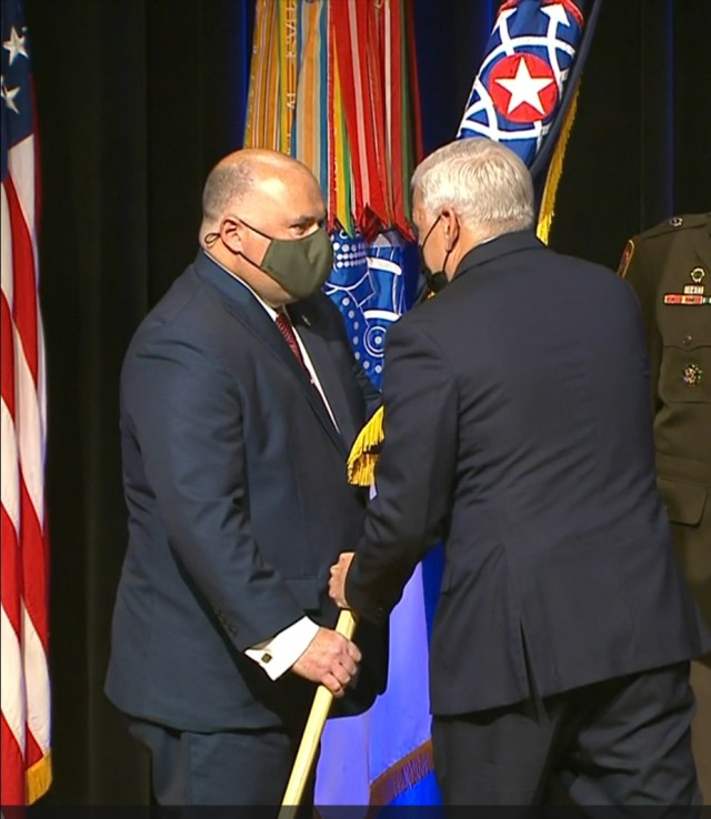 SA Gregory Ford, left, accepts the CID colors from Christopher Lowman, during the CID Transfer of Authority ceremony at the Pentagon, Sept 17.