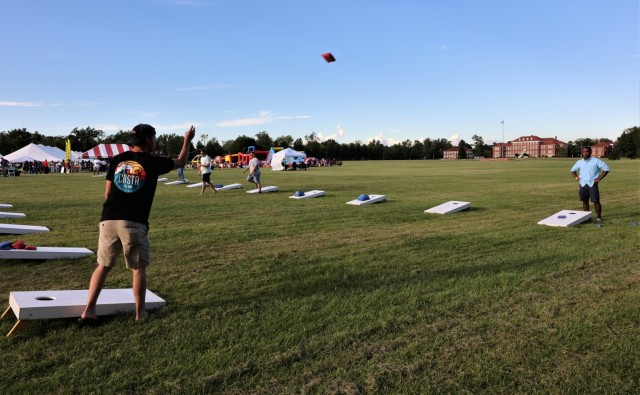 Participants toss bean bags during the cornhole tournament on Brooks Field at the annual Fort Knox Oktoberfest celebration Sept. 17, 2021. Cash prizes were awarded to the winners.