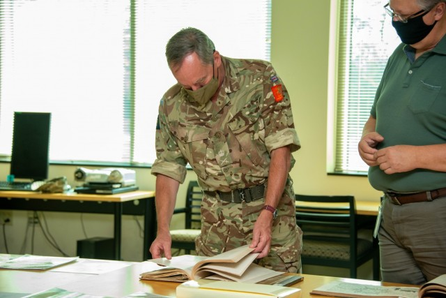Lt. Gen. Sir Christopher Tickell, U.K. Army Deputy chief of the general staff visits the Army Heritage and Education Center. Mr. Stephen Bye is showing Tickell rare books and materials on New Zealand fortifications.