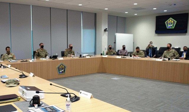 Lt. Gen. Stephen G. Fogarty, commander of U.S. Army Cyber Command (second from left) leads discussion of concepts, initiatives and requirements in the evolution of information advantage (IA) in competition and conflict, during the ARCYBER Information Advantage Summit at Fort Gordon, Ga., Sept. 21, 2021. Participants in the two-day event included senior military and civilian leaders from Army, Department of Defense, and multinational and interagency partner forces that are working together to develop IA capabilities. (Photo by Joe McClammy)