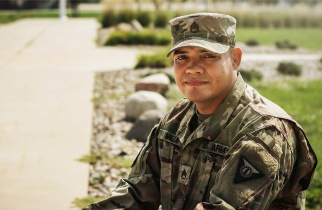 Staff Sgt. Henry Meza, an Iowa Army National Guard Soldier who works with the Service to Citizenship program, poses for a photo at the Camp Dodge Joint Maneuver Training Center in Johnston, Iowa, on Sept. 7, 2021. Meza grew up with a large family in Honduras, and became a U.S. citizen in 2013. He attributes his welcoming demeanor and work ethic to his Hispanic heritage and assists young people in the process of achieving citizenship through the Guard. (U.S. Army National Guard photo by Staff Sgt. Tawny Schmit)
