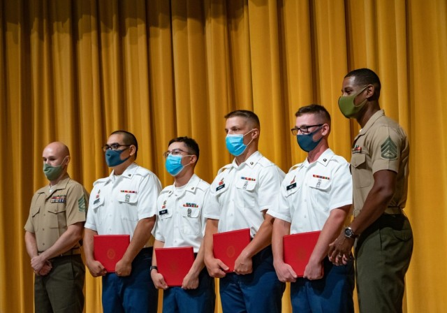 OKINAWA, Japan – From left to right, U.S. Marine Corps Gunnery Sgt. Matthew Nebergall, Marine Air Support Squadron 2 instructor; U.S. Army Spc. Ignacio Delgadillo, Spc. Uriel Trejo, Spc. Jaden Kinney, and Spc. Robert Watt, all assigned to 1st Battalion, 1st Air Defense Artillery Regiment; and U.S. Marine Corps Gunnery Sgt. Michael Ford, Marine Air Support Squadron 2 instructor gather at the MASS-2 command-sponsored corporals school closing ceremony at Marine Corps Air Station Futenma Sept. 3, 2021. Four Soldiers with 1-1 ADA graduated the three-week school designed to provide students the knowledge and skills necessary to be successful small-unit leaders. (U.S. Army photo by 1st Lt. Daniel Andrews, 1-1 ADA)
